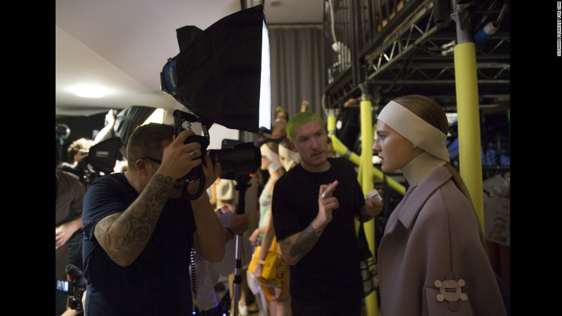 "A photographer shoots a model backstage before the start of the Anya Hindmarch catwalk show. With multiple photographers vying for position in the pit, things can get competitive. ""I've got to admit I lost my temper a bit at one of the shows, when I arrived and saw my spot had been half-taken by another photographer,"" says Isabel Infantes at her first London Fashion Week. ""I panicked a bit but in the end we made peace."""
