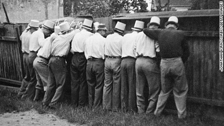 Probable beer-soaked men at an Octoberfest celebration in Germany urinate in unison along a wooden fence.  (Photo by Jonathan Kirn/Corbis via Getty Images)