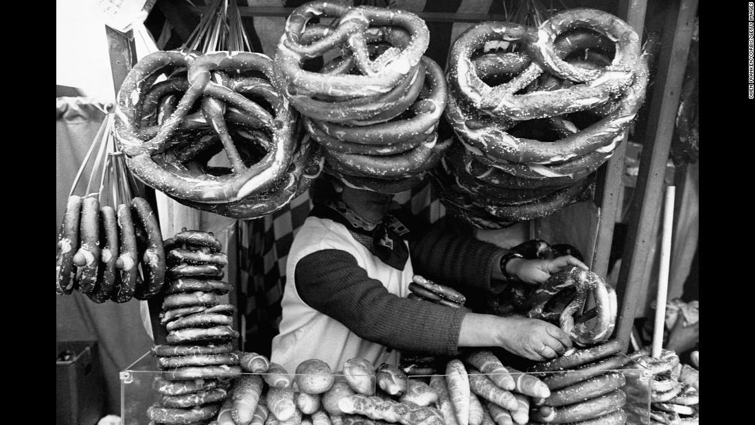 Massive pretzels obscure a food vendor's face in Munich.