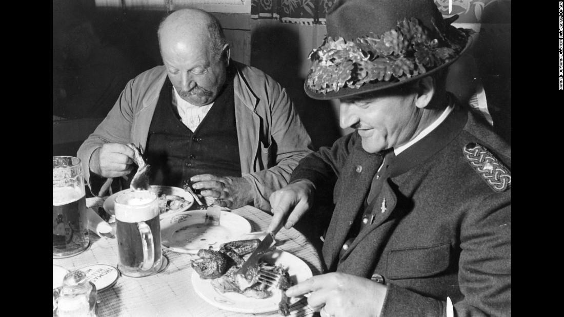 Visitors eat a meal during Oktoberfest celebrations in Munich in 1935.