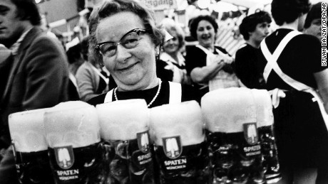 A waitress has to carry heavy litre tankards (12.09.1979) at the Oktoberfest. Now the tax and revenue office demands its share for the tip which goes beyond the legitimate twelve percent. Photo by: Istvan Bajzat/picture-alliance/dpa/AP Images