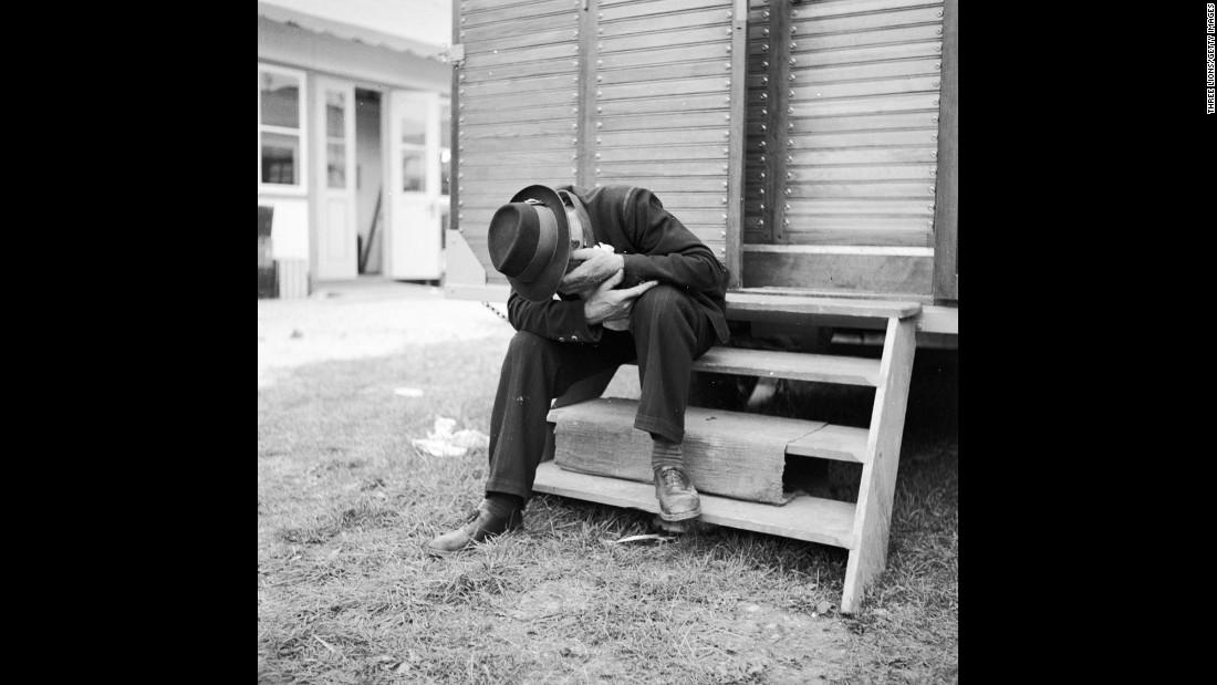 A hangover perhaps? A man lowers his head during Oktoberfest circa 1950.