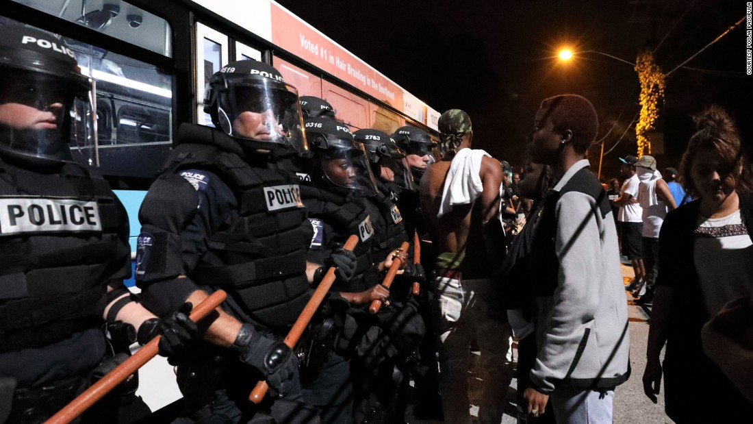 Police officers face off with protesters on the first night of demonstrations.