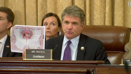 Texas Rep. Michael McCaul holds up a picture of Ahmad Rahami's journal during a House Homeland Security hearing on Wednesday, September 21.