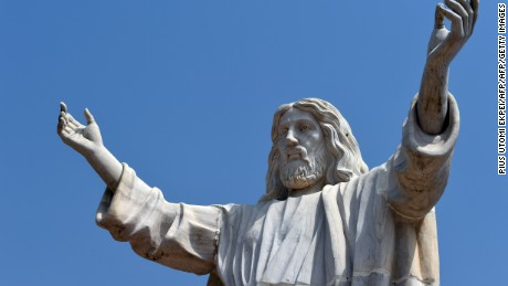 "A picture taken on January 1, 2016 shows the nine-metre tall statue of Jesus Christ carved from white marble, thought to be the biggest of its kind in Africa, unveiled in Abajah, southeastern Nigeria. Standing barefoot with arms outstretched, the ""Jesus de Greatest"" statue weighs in at 40 tonnes. More than 100 priests and hundreds of Catholic worshippers attended the nine-metre (30-foot) statue's official unveiling in the village of Abajah in southeastern Nigeria. It was commissioned by Obinna Onuoha, a local businessman who hired a Chinese company to carve it and placed it in the grounds of a 2000-capacity church that he built in 2012. / AFP / PIUS UTOMI EKPEI        (Photo credit should read PIUS UTOMI EKPEI/AFP/Getty Images)"
