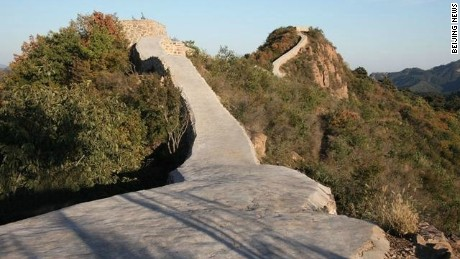 A photo posted on China's internet showing the Great Wall repaired with cement.
