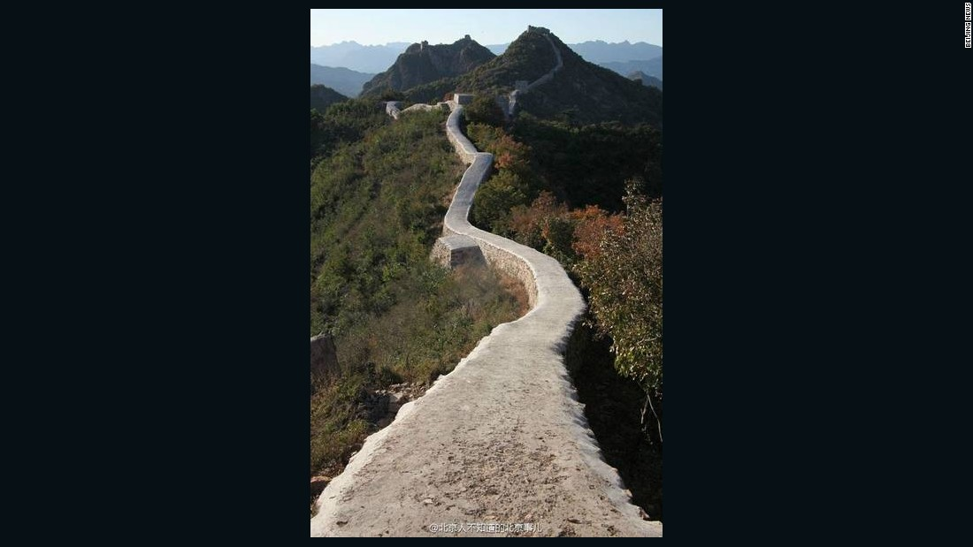"The Great Wall stretches from Hebei province in the east to Gansu province to the west, and stretches over 220,000 kilometers. This photo shows a section of the wall near the border of Liaoning and Hebei province that was repaired in 2014. Great Wall of China Society deputy director Dong Yaohui said the repair was done ""very badly"""