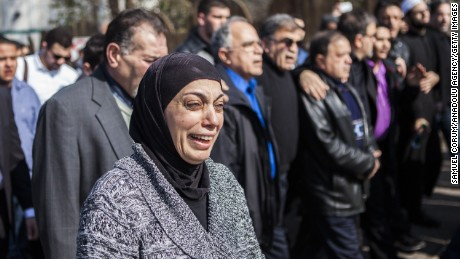 RALEIGH, UNITED STATES - FEBRUARY 12 : Mourners and people from the Islamic Association of Raleigh attend a service at a nearby soccer field February 12, 2015 in Raleigh, North Carolina. Community members and loved ones gathered to mourn the murders of Deah Shaddy Barakat, Yusor Abu-Salha and Razan Mohammad Abu-Salha who were shot Tuesday afternoon. (Photo by Samuel Corum/Anadolu Agency/Getty Images)