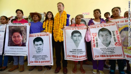 The representative for Mexico of the UN High Commissioner for Human Rights, Jan Jarab (C) poses with family members and relatives of missing students after a meeting at the Raul Isidro Burgos rural school in Ayotzinapa, Guerrero state, Mexico on September 21, 2016.  Jarab is in Ayotzinapa to meet with relatives of the 43 missing students to mark the two-year anniversary of their disappearance. / AFP / ALFREDO ESTRELLA        (Photo credit should read ALFREDO ESTRELLA/AFP/Getty Images)