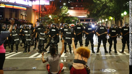 CHARLOTTE, NC - SEPTEMBER 21:  Police clash with protestors as residents and activists protest the death of Keith Scott September 21, 2016 in Charlotte, North Carolina. Scott, who was black, was shot and killed at an apartment complex near UNC Charlotte by police officers, who say they warned Scott to drop a gun he was allegedly holding.  (Photo by Brian Blanco/Getty Images)