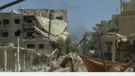 A walk through damage in Darayya, Syria