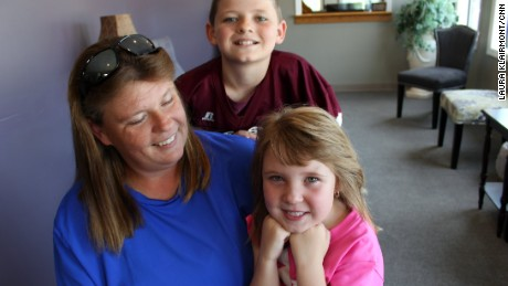 The Hill family, patients of Dr. Smith, show off their smiles.