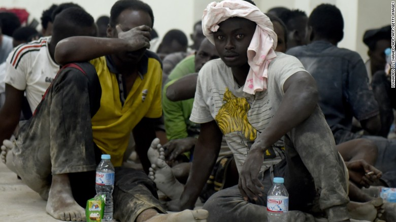 Survivors from the boat sit in a police station in Rashid on September 21.