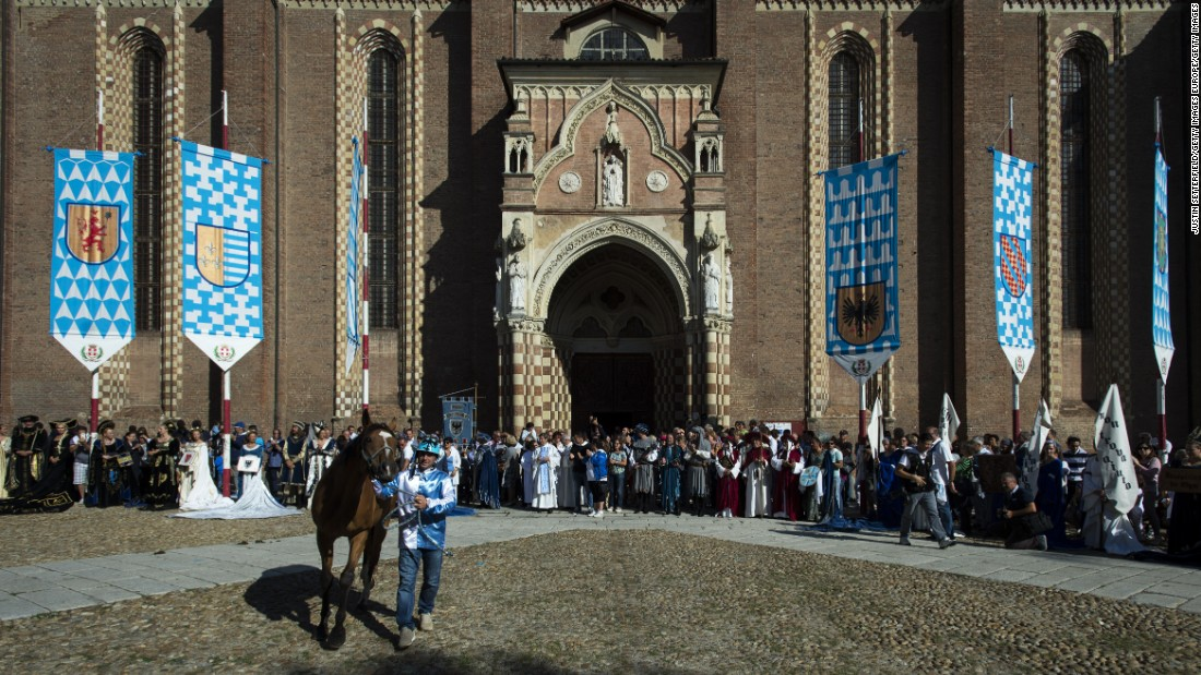 A horse and jockey are blessed outside Asti Cathedral ahead of the 2016 Palio on September 18.