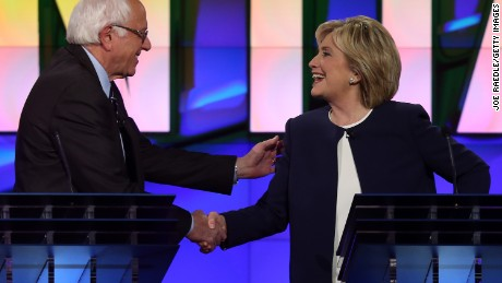 Democratic presidential candidates U.S. Sen. Bernie Sanders and Hillary Clinton shake hands at the end of a presidential debate sponsored by CNN and Facebook at Wynn Las Vegas on October 13, 2015 in Las Vegas, Nevada.
