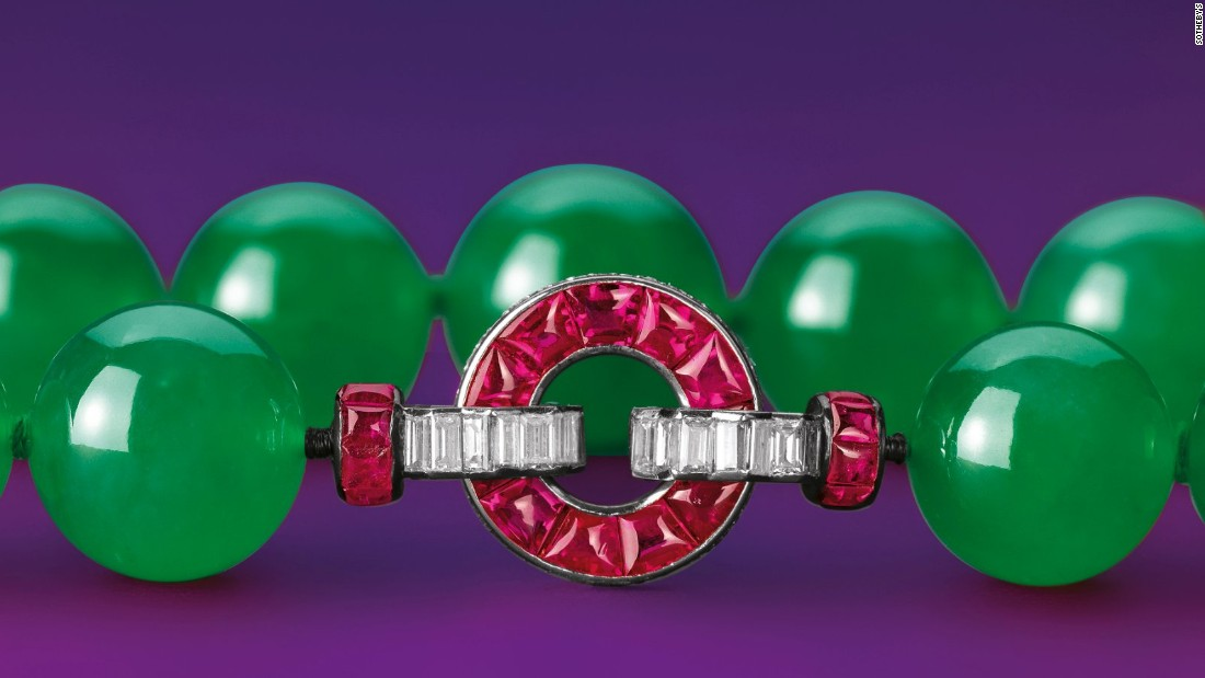 The ruby and diamond clasp was designed by Cartier, and the piece was eventually purchased by the Cartier Collection after a reported 18 minutes of bidding.