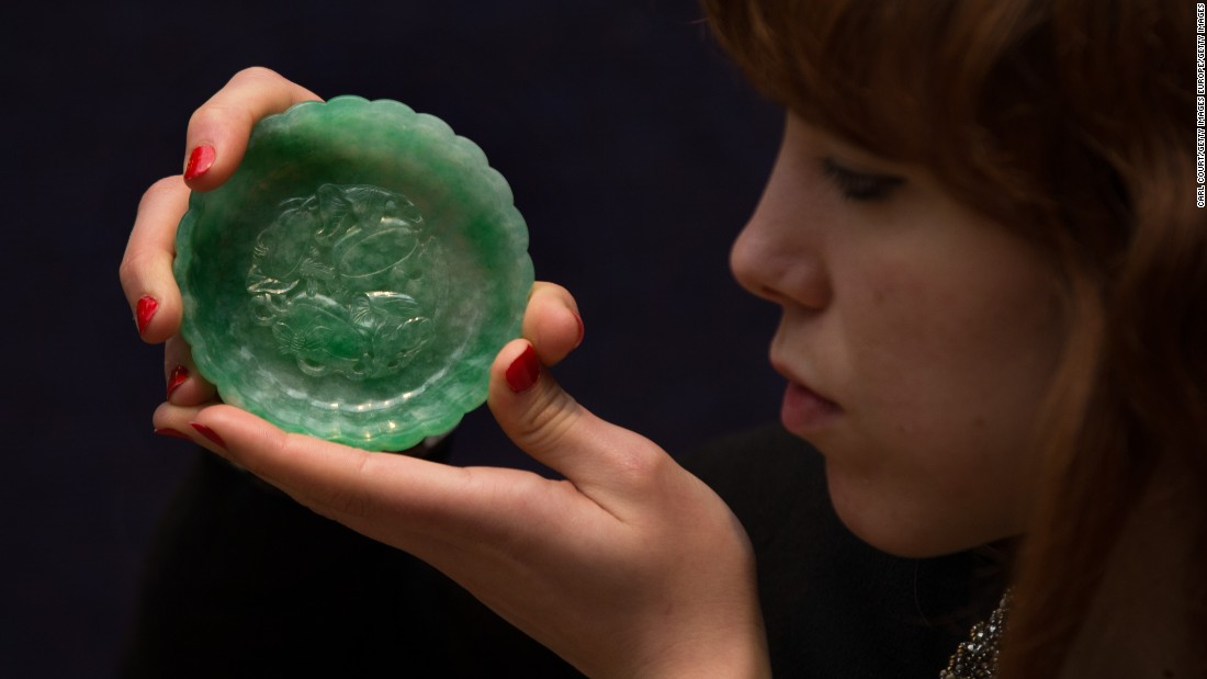 """It may look tiny, but this """"exceptional apple-green jadeite 'chrysanthemum' washer"""" fetched over $140, 000 at a Bonhams auction in May 2016 in London."""