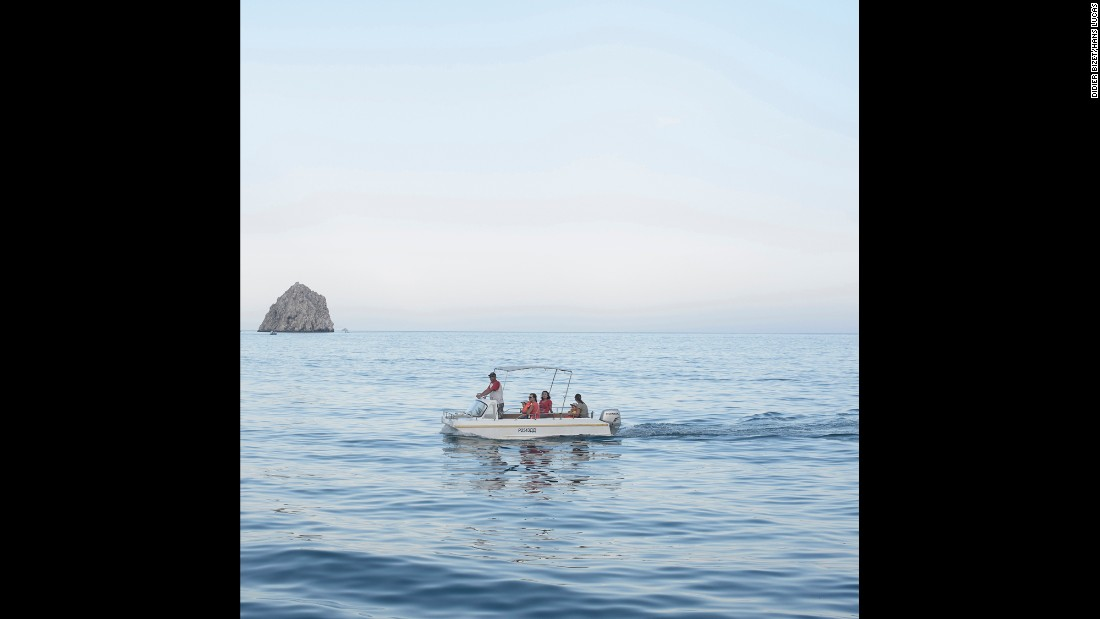 People ride on a boat in the seaside resort of Gurzuf.