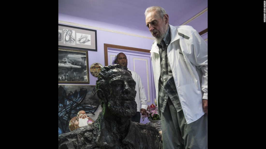 """Fidel Castro stands next a statue of himself given to the ex-Cuban president by a Chinese artist. Despite receiving gifts such as this, his father does not want """"a cult of personality,"""" Castro's son and photographer Alex Castro says."""