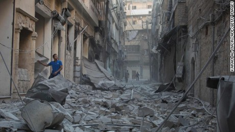 TOPSHOT - A Syrian man stands in the rubble of destroyed buildings following an air strike in Aleppo's rebel-controlled neighbourhood of Karm al-Jabal on September 18, 2016.Syria's ceasefire was on the brink of collapsing on September 18, after a US-led coalition strike killed dozens of regime soldiers and Aleppo city was hit by its first raids in nearly a week. / AFP PHOTO / KARAM AL-MASRIKARAM AL-MASRI/AFP/Getty Images