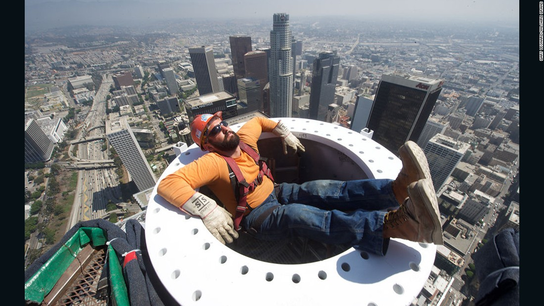 Construction worker at the Wilshire Grand Center takes a hair-raising break over 1,000 feet above Los Angeles.