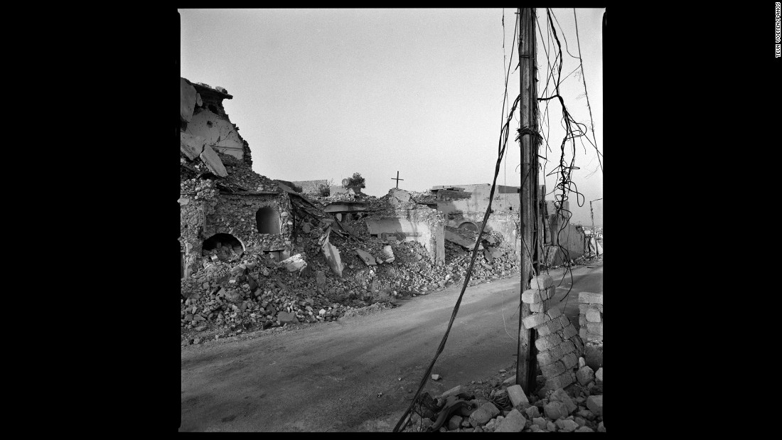 Destroyed buildings line a street in Sinjar, Iraq. The town was taken over by the ISIS militant group in August 2014. It was liberated in 2015, but it no longer looks the same.