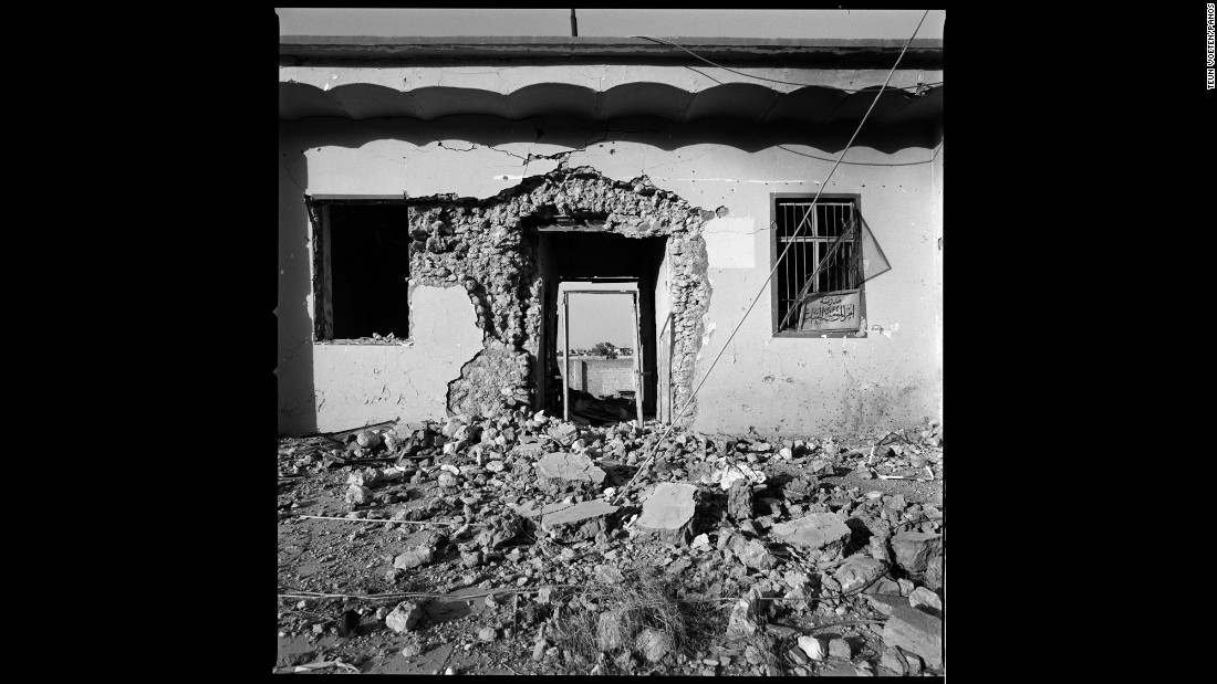 """The entrance to a heavily damaged house in Sinjar. Voeten has covered wars for about 25 years, but he said this was """"destruction on a scale I have rarely witnessed before."""""""