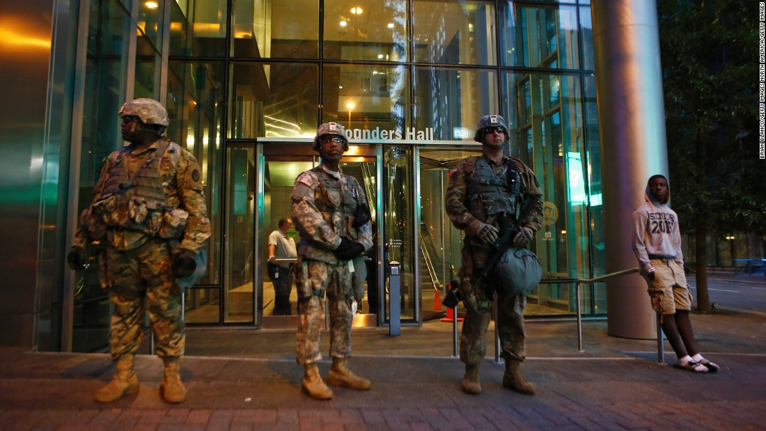 National Guardsmen stand at their post in downtown Charlotte on September 22.
