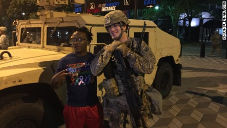 Charlotte: Protester poses with National Guardsman