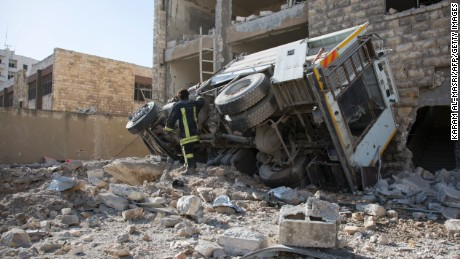 A Syrian man checks the damage following an air strike in the rebel-held Ansari district in Aleppo on Thursday, September 23.