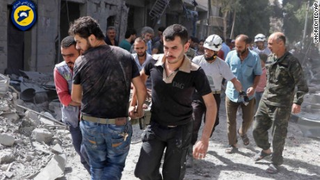 Rescue workers work the site of airstrikes in al-Mashhad neighborhood in the rebel-held part of eastern Aleppo, Syria, Wednesday Sept. 21, 2016.