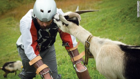 Goat man Thomas Thwaites bonds with an actual goat in the Alps.