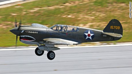Flying Tiger vet Frank Losonsky, 96, flew Thursday in the back of a fighter plane like those he worked on in the 1940s.