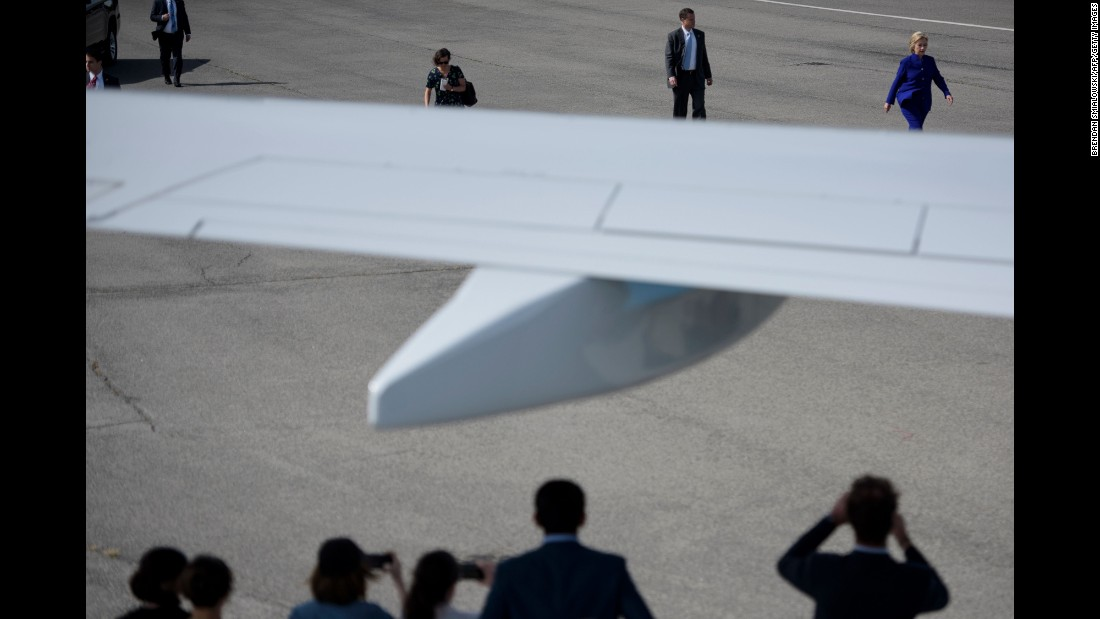 Democratic presidential nominee Hillary Clinton walks to her plane at an airport in White Plains, New York, on Wednesday, September 21.