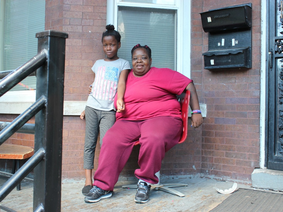 Etyra with her grandmother on the porch where she was shot