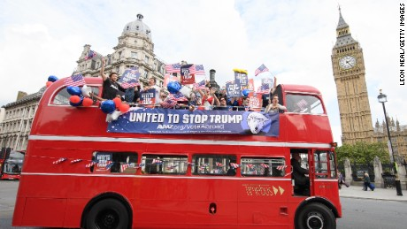 LONDON, ENGLAND - SEPTEMBER 21:  The 'Stop Trump' campaign bus travels around Parliament Square, urging American expats across the UK to register and vote in the US election in November, on September 21, 2016 in London, England. Millions of Americans live abroad (over 220,000 in the UK), but only 12% of them vote, and the deadline to register is fast approaching in some US states.  (Photo by Leon Neal/Getty Images)