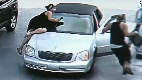woman jumps on thief's car