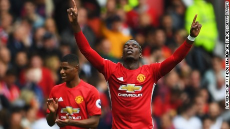 MANCHESTER, ENGLAND - SEPTEMBER 24: Paul Pogba of Manchester United celebrates scoring his sides fourth goal during the Premier League match between Manchester United and Leicester City at Old Trafford on September 24, 2016 in Manchester, England.  (Photo by Laurence Griffiths/Getty Images)