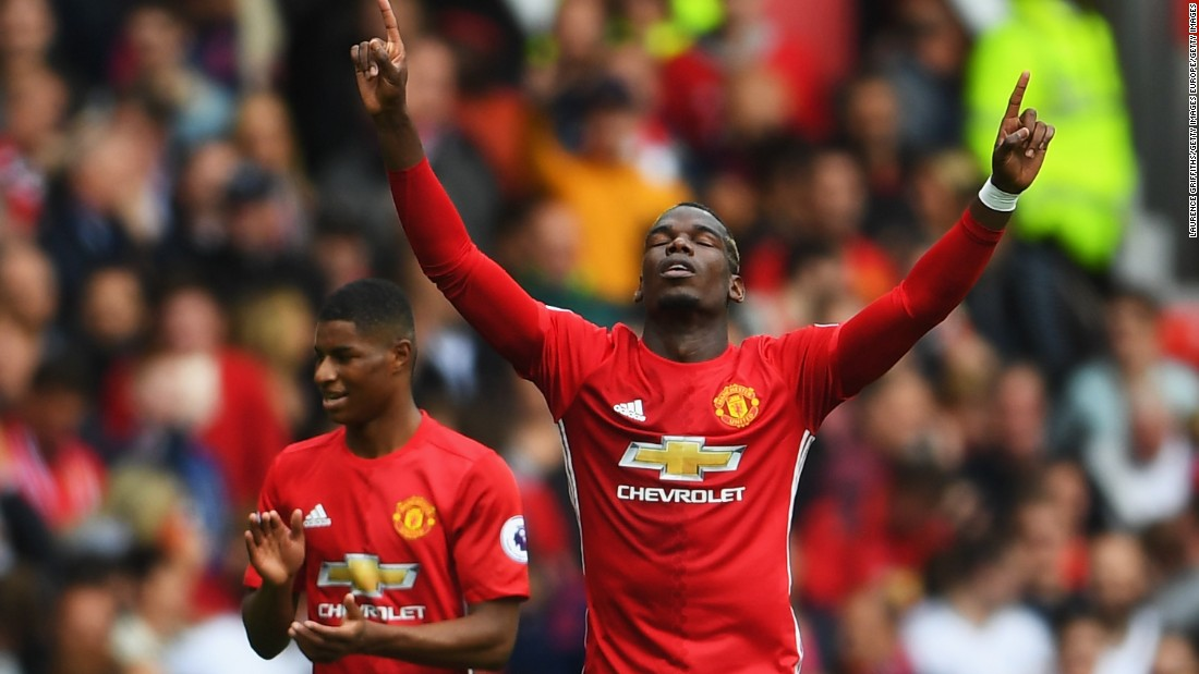 Paul Pogba of Manchester United celebrates scoring his side's fourth goal -- and his first for the Red Devils -- during the Premier League match between Manchester United and Leicester City at Old Trafford on September 24, 2016.