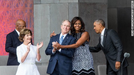 Former US First Lady Laura Bush, former US President George W. Bush, First Lady Michelle Obama, and President Barack Obama attend the opening ceremony for the Smithsonian National Museum of African American History and Culture on September 24, 2016 in Washington, D.C.