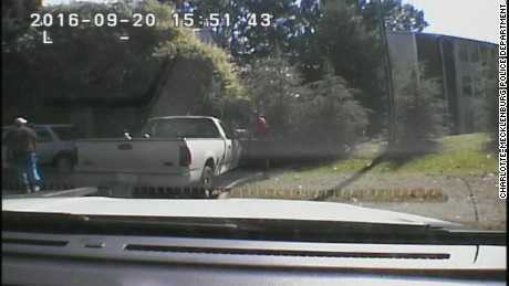 An image taken from dashcam video released by the Charlotte-Mecklenburg Police Department showing the moment before officers shot and killed Keith Scott.