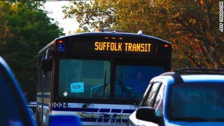 A Suffolk County transit bus drives through Babylon, New York in September.