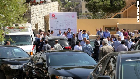 An ambulance transports the body of Jordanian writer Nahed Hattar to a medical facility, after he was shot, in Amman, Jordan, Sunday, September 25, 2016. The prominent writer was shot dead in front of the courthouse where he was on trial for sharing a cartoon deemed as offensive to Islam. (AP Photo/Raad Adayleh)