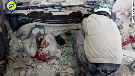 On Friday afternoon a photo of a father and son who had fallen victim to the war emerged. Covered in blood and dust, the pressure of the rubble holding their final postures in place.