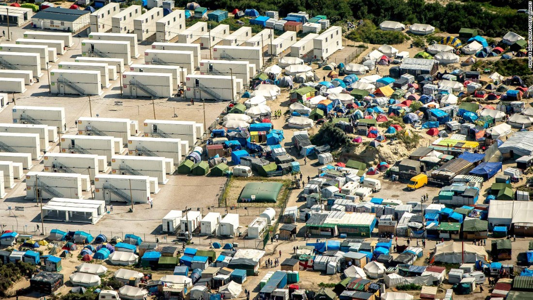 Calais camp will be completely dismantled, says French president