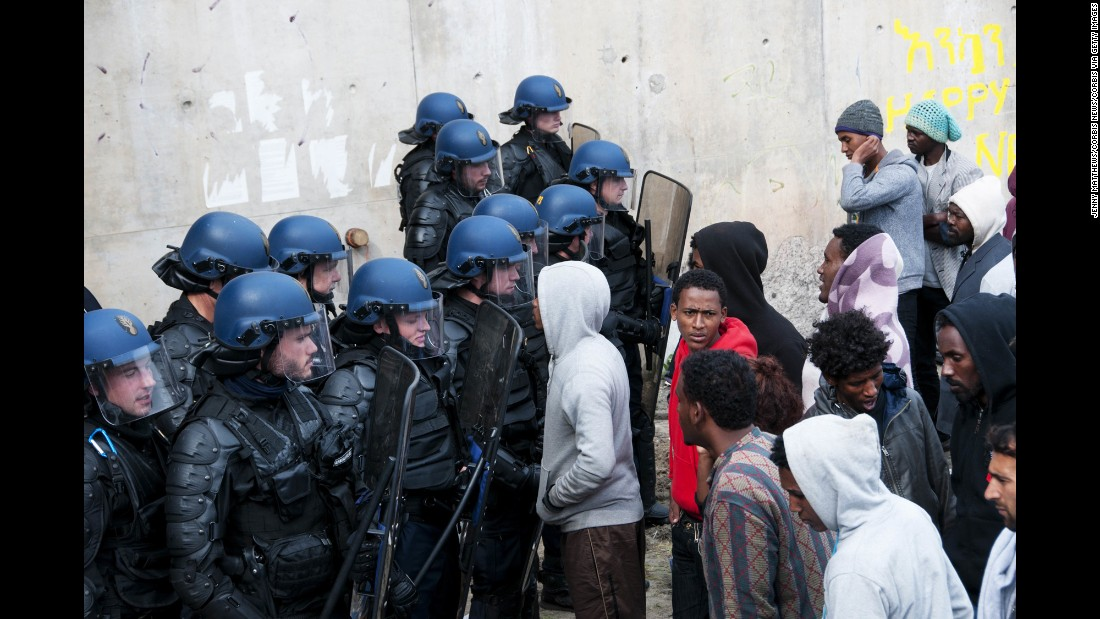 French police oversee the removal of tents on September 21.