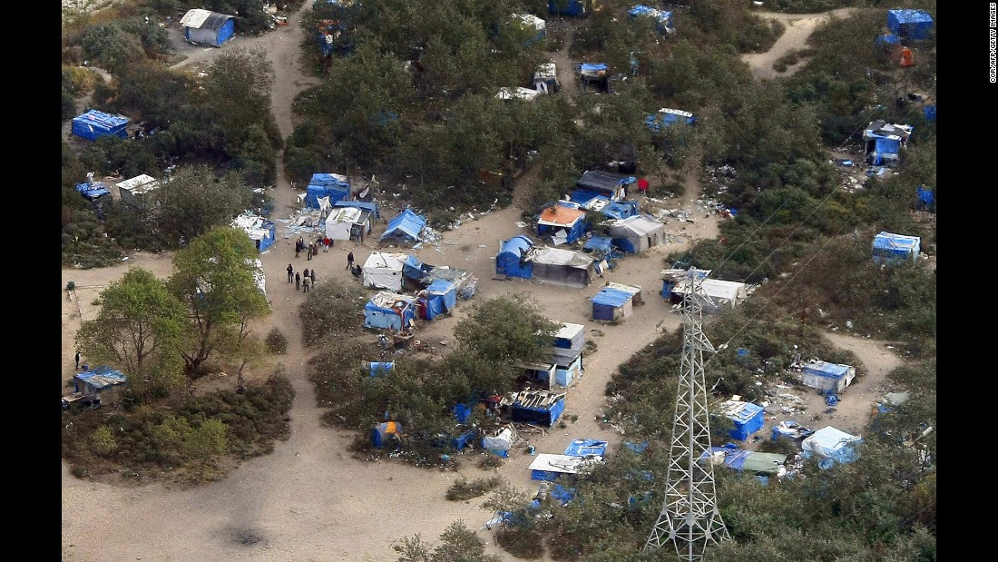"An aerial view taken on September 21, shows the area known as ""The Jungle"" in Calais, where hundreds of migrants gather to try to gain passage to Britain."
