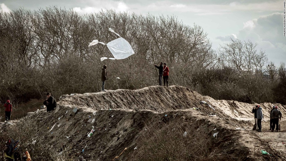 A migrant flies a kite on February 19.