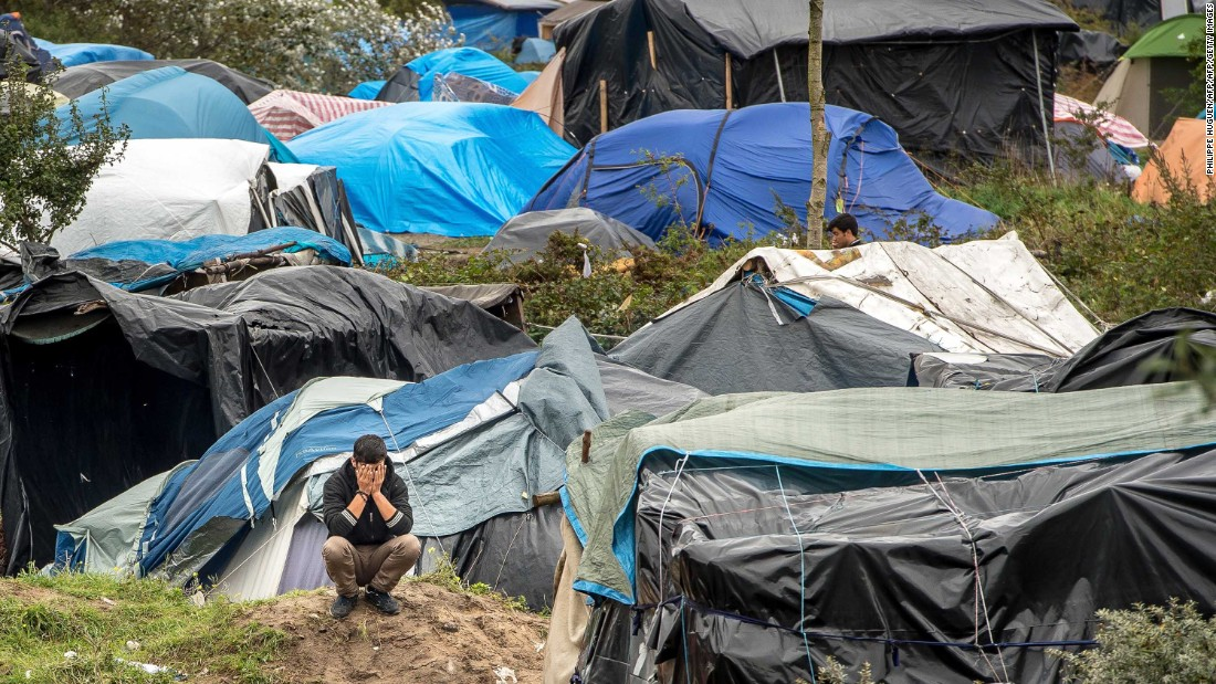 "A man is seen among tents in ""The Jungle"" on October 7. Despite several efforts to close the site, migrants and refugees continue to arrive in Calais."