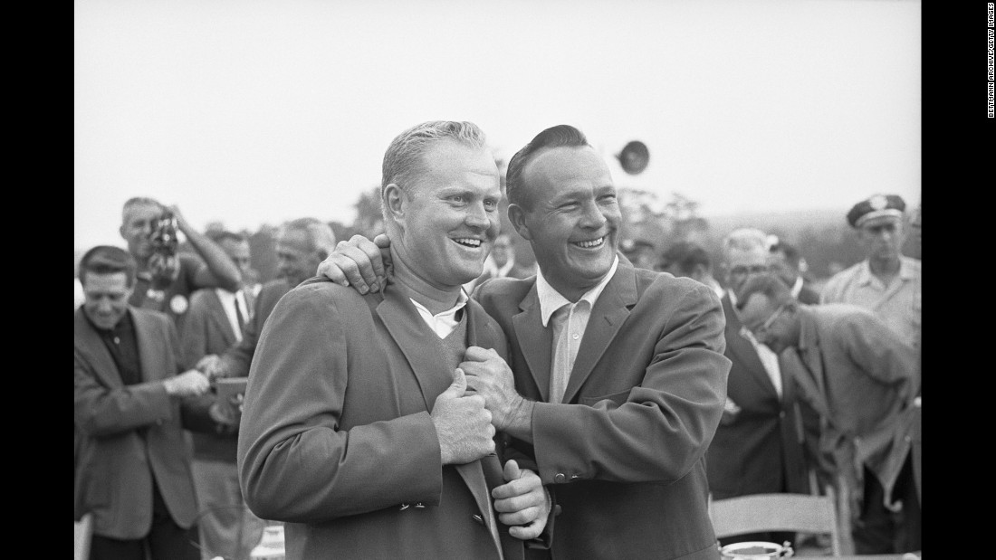 Defending champion Palmer, right, poses with Jack Nicklaus, who won his second Masters title and set a new tournament record on April 11, 1965.
